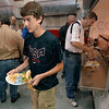 Tribune-Star/Joseph C. Garza<br /> A typical meal at a soup kitchen: Spencer Danielson, 15, carries a plate of tuna casserole and salad back to his seat Friday at Ryves Youth Center at Etling Hall. Danielson's mother, Lori, is participating in the United Way's Hunger Challenge and Spencer and his sister, Ali, are going to help her along the way.