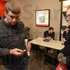 Tribune-Star/Joseph C. Garza<br /> No time to waste: Indiana State University student Ben Ewick of Greenwood checks out his new iPhone with fellow student and Greenwood resident Ryan Gwin Friday at Verizon Wireless.