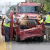 Rescue: Emergency personnel remove a crash victim from a vehicle on US 40 just east of Main Street in Seelyville Friday afternoon. The vehicle was involved in a chain-reaction accident that involved several vehicles.