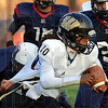 Wait a minute: Warren Central quarterback Anthony Cooper-Taylor is caught from behind by Terre Haute North's Lee Davis as fellow Patriot Chris Spencer(35) comes in to help.