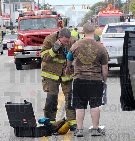 Blood pressure: The driver of a vehicle involved in a chain-reaction accident on US 40 in Seelyville gets his blood pressure checked at the scene Friday afternoon.