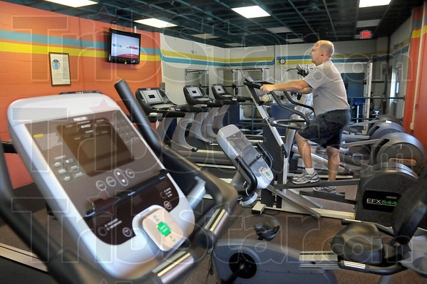 Workout: Wing Commander Colonel Donald Bonte goes through his workout in the base facility Friday afternoon.