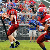 Lookin': Linton quarterback Austin Karazsia looks at his potential receiver #26 Zane Hayden during first quarter action against West Vigo.