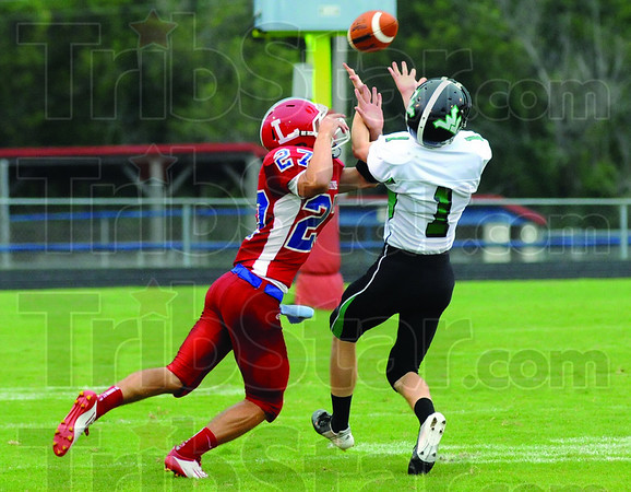 Incomplete: Linton's #27 Grant Stamm is denied the ball by West Vigo defender #1 Jimmy Maples during first quarter action Friday evening before lightning in the sky postponed the game.