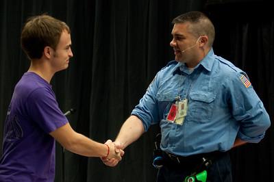 Mason Kellar shakes Tom Bowen's hand after he spoke in Dimensions on Spetember 11, 2012.