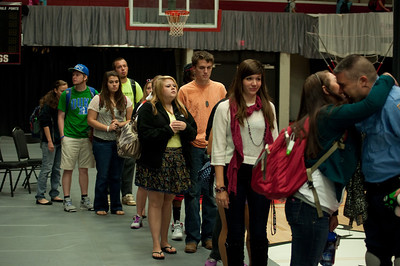 Students line up to shake the hand of Tom Bowen after he spoke in Dimensions on Spetember 11, 2012.