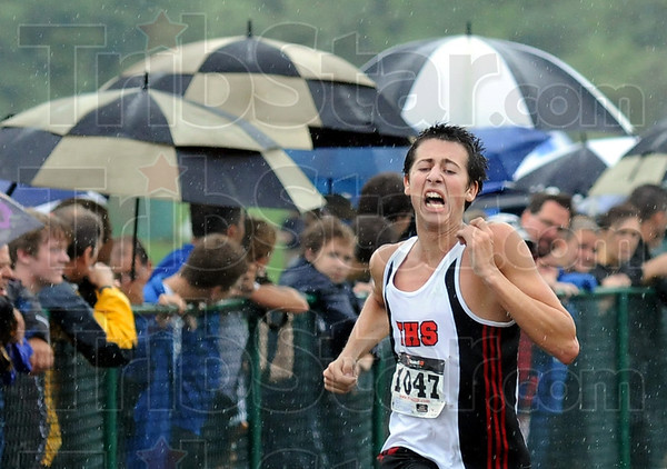 Finish: South's Devon Fuson strains as he sprints through the falling rain the last few yards of the Terre Haute Savings Bank boys varsity event Saturday morning.