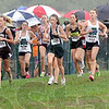 Rainy run: A cluster of runners finish the girls varsity event at the Terre Haute Saving Bank Invitational cross country meet Saturday morning during a light rain.