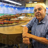 Tribune-Star/Jim Avelis<br /> My town: Model railroader Larry Schute poses with his scale model town in the background.
