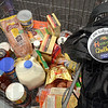 Tribune-Star/Joseph C. Garza<br /> No snacks, just the staples: Lori Danielson's Hunger Challenge participation button can be seen on her purse as she prepares to unload groceries that she and her husband will eat for a week Saturday, Sept. 15 in the Aldi's parking lot.