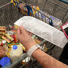 Tribune-Star/Joseph C. Garza<br /> Could you do it?: Lori Danielson, a participant in the United Way of the Wabash Valley's Hunger Challenge, shows what little she could buy for herself and husband, Steve, to eat for a week last Saturday in the Aldi's parking lot.