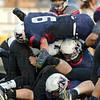 Tribune-Star/Jim Avelis<br /> Swarmed: Warren Central quarterback Anthony Cooper-Taylor is swarmed by Terre Haute North Patriots including Lee Davis (9).