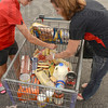 Tribune-Star/Joseph C. Garza<br /> Have to make it last: Lori Danielson, right,  and her daughter, Ali Danielson, 14, unpack their cart after Lori bought what she could at Aldi's Sept. 15 to participate in the Hunger Challenge.