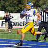 Score: South Dakota State's #31, Zach Zenner crosses the goal line to score the first touchdown of the game against Indiana State Saturday afternoon. South Dakota State went on to win the game 24-10. (AP Photo/Tribune-Star)