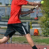 Tribune-Star/Joseph C. Garza<br /> Backhand out of the corner: Terre Haute South's Nathan Bogle returns a backhand to North Central opponent Brennan Crooks during their no. 1 singles match Saturday at South.