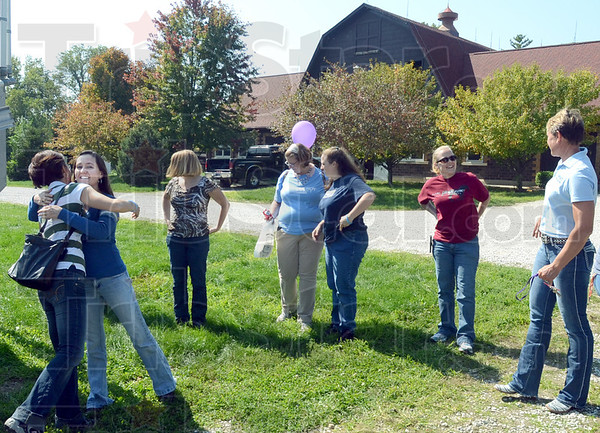 Equine: Former St. Mary's equine students meet and greet at the stables on campus Saturday afternoon.
