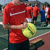 Tribune-Star/Joseph C. Garza<br /> Sign here: Terre Haute South's Nathan Bogle signs a giant tennis ball after he won his No. 1 singles sectional championship match over North Central's Brennan Crooks Saturday at South.