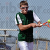 Tribune-Star/Joseph C. Garza<br /> Chased it down: North Central's Brennan Crooks chases down a backhand during his no. 1 singles sectional championship match Saturday at South.