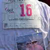Tribune-Star/Joseph C. Garza<br /> In loving memory: A participant in Saturday's Susan G. Komen Race for the Cure wears a photo of her mother during the event at Memorial Stadium.