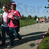 Tribune-Star/Joseph C. Garza<br /> Walking for a cure: Lorraine Pleus, right, of Farmersburg walks with her arm around with Rylee Mason, 10, during the Susan G. Komen Race for the Cure Saturday at Memorial Stadium.