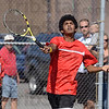 Tribune-Star/Joseph C. Garza<br /> Putting it away: Terre Haute South's Krishan Kumar closes in a short ball at the net to put it away during his no. 2 singles sectional match Saturday at South against North Central's Jacob Chmielewski.