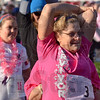 Tribune-Star/Joseph C. Garza<br /> Stretch it out: A participant in Saturday's Susan G. Komen Race for the Cure stretches with her fellow walkers and runners with the Indiana State University women's basketball team before the event at Memorial Stadium.