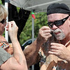 Taste test: Terre Haute residents Cheryl and Norman Smith taste several versions of chili during Saturday's annual Altrusa Cook-off.