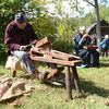 Tribune-Star file photo<br /> Historical lesson: Charlie Carson and Margaret Carson volunteer at Pioneer Days at Fowler Park showing family how to carve wooden utensils Oct. 1, 2011.