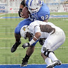 Indiana State's #92 Ben Obaseki steps into the end zone to score a touchdown with little resistance from a Quincy defender. Indiana State beat Quincy 44-0 at Memorial Stadium Saturday. (AP Photo/Tribune-Star Bob Poynter)