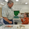 Tribune-Star/Jim Avelis<br /> Quizzed: Randy Staley of Staley's Soil Service Inc. quizzes Kyler  Neal about different rocks. The two were at Clay County's Nature Days Saturday morning.