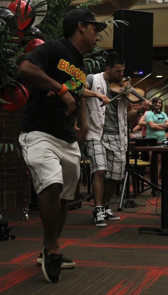 Gardner-Webb Sophomore Ethan Senger dances to Bulgarian hip-hop violinist Svet's performance in the Tucker Student Center on September 27.