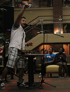 Bulgarian hip-hop violinist Svet sings during his performance for GWU in the Tucker Student Center on September 27.