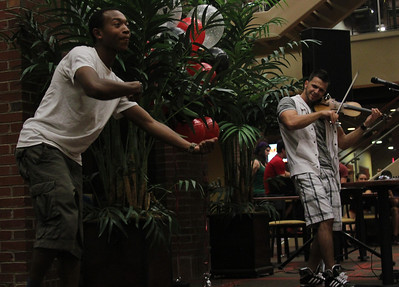 Gardner-Webb Junior Cory Palmer playfully imitates Bulgarian hip-hop violinist Svet during the performance in the Tucker Student Center on September 27.
