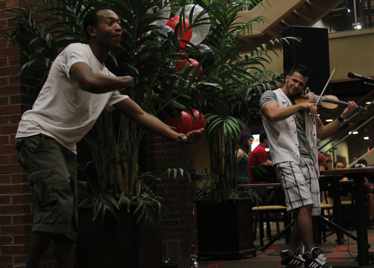Gardner-Webb Junior Cory Palmer playfully imitates Bulgarian hip-hop violinist Svet during the performance in the Tucker Student Center on September 27.