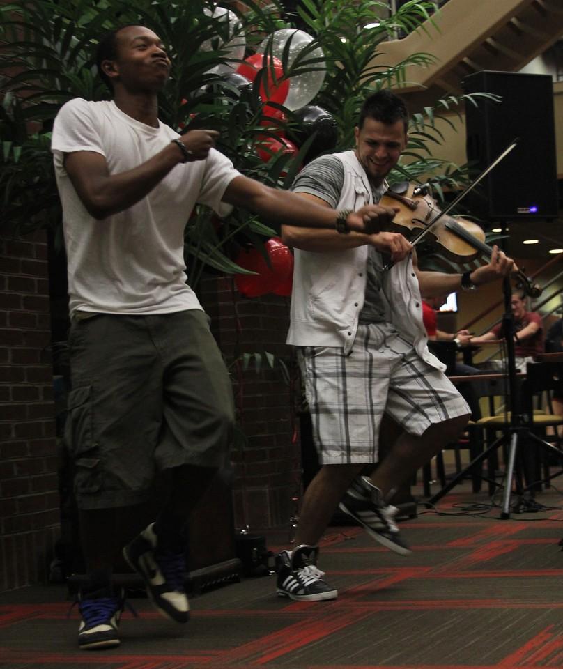 Gardner-Webb Junior Cory Palmer and Bulgarian hip-hop violinist Svet break it down together during Svet's performance in the Tucker Student Center on September 27.