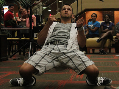 Bulgarian hip-hop violinist Svet dances during his performance for GWU in the Tucker Student Center on September 27.