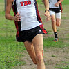 Tribune-Star/Jim Avelis<br /> Leaning toward home: Terre Haute South's Jackson Bertoli leans around the last cone on his way to a first place finish in the boy's county cross country meet Wednesday evening at Rea Park.