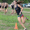 Tribune-Star/Jim Avelis<br /> Separation: Eventual winner Chanli Mundy rounds the first cone in the girl's county cross country meet, already well ahead of the rest of the pack.