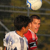 Tribune-Star/Jim Avelis<br /> In close: Terre Haute North's Jacob Wilson and South's Scout Wrin try to control the ball in close to the Braves goal.