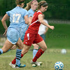 Tribune-Star/Jim Avelis<br /> Busting loose: Rose-Hulman forward Katie DeMoss breaks through the defense of St. Mary-of-the-Wood's defenders Katie Kniola(17) and Liz DeMoss in first half action. Katie DeMoss scored on the play.