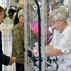 Tribune-Star/Joseph C. Garza<br /> Go, Martha, go!: Martha Alwardt of Paris, Ill., tries her hand at grabbing as many contest entry forms as possible in the Love Financial Services wind tunnel Wednesday at the Senior Expo at Hulman Center.