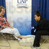 Tribune-Star/Joseph C. Garza<br /> Free for the feet: Vickie French takes advantage of a free screening test for osteoporosis Wednesday at the Senior Expo at Hulman Center. Conducting the test is Amber Denny of UAP Clinic.