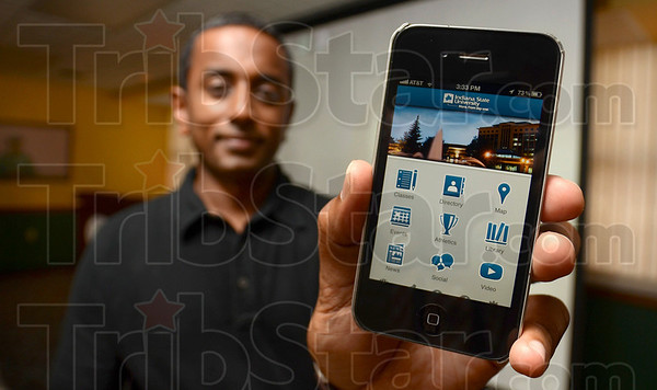Tribune-Star/Joseph C. Garza<br /> New app: Santhana Naidu, web services director in Indiana State's Office of Communications, shows off the university's new mobile phone app, ISU Mobile, after a press conference in the Hulman Memorial Student Union Wednesday.