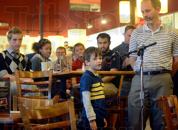 Tribune-Star/Joseph C. Garza<br /> Civic engagement: Seven-year-old Nathan Hawkins asks Mayor Duke Bennett a question about his neighborhood as Nathan's dad, Timothy, right, looks on Monday at the Grand Traverse Pie Company.