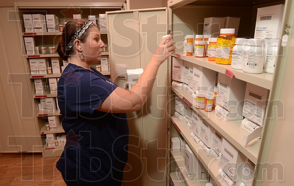Tribune-Star/Joseph C. Garza<br /> Helping with medication cost: Kelly Scamihorn, R.N., stocks medication at the Employee Health and Wellness Center for Vigo County School Corporation employees Monday. The center has medication on hand for corporation employees and some if it is at no cost to the them.