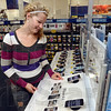 Tribune-Star/Joseph C. Garza<br /> iPhone 5 coming soon: Indiana State student Callie Walker of Greencastle looks over the iPhone display at BestBuy Friday.