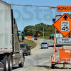 Tribune-Star/Joseph C. Garza<br /> For highway safety: Motorists traveling east on I-70 pass on of many worksite signs Monday near the INDOT weight station just past the state line.