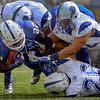 Tribune-Star/Joseph C. Garza<br /> Takes three to take him down: Indiana State University running back Shakir Bell is tackled by a trio of Drake defenders during the Sycamores' win Saturday, Sept. 15 at Memorial Stadium.