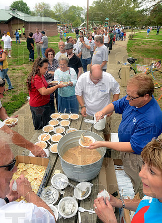 Tribune-Star/Joseph C. Garza<br /> Labor Day tradition: Volunteers, including Norm Loudermilk and candidate Jim Mann, serve soup beans at Fairbanks Park after Monday's Labor Day parade.