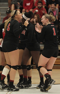 Emily Holte (15) and Heather Feldman (1) rejoice after a good play